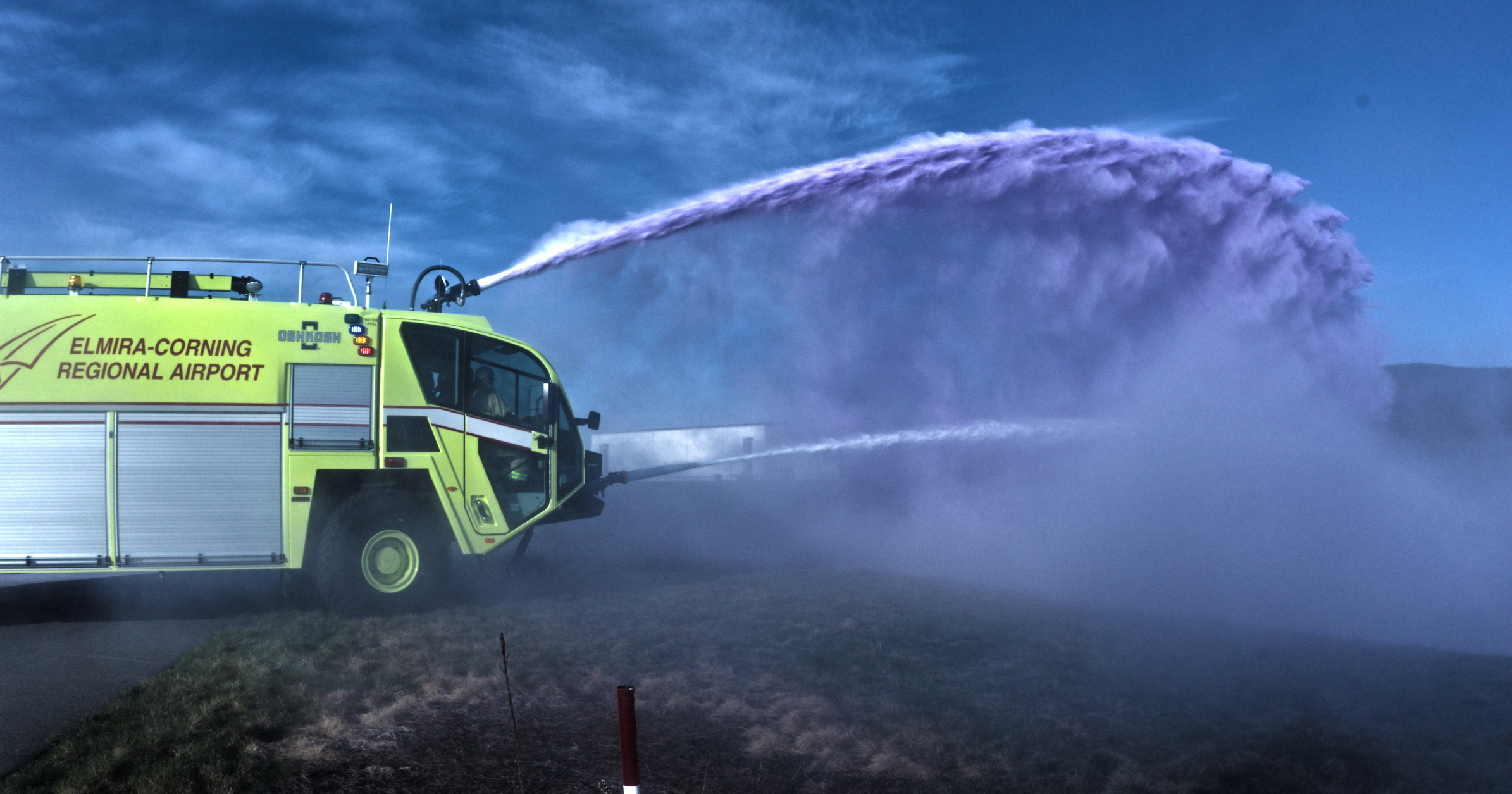 Airport fire truck spraying PFAS-containing firefighting foam on fire