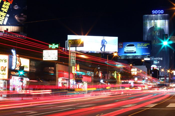Sunset Strip billboards captured at night with a long exposure of car lights.