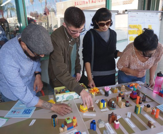 Community members interact with a toy city as part of the South Colton Livable Corridor Plan outreach process